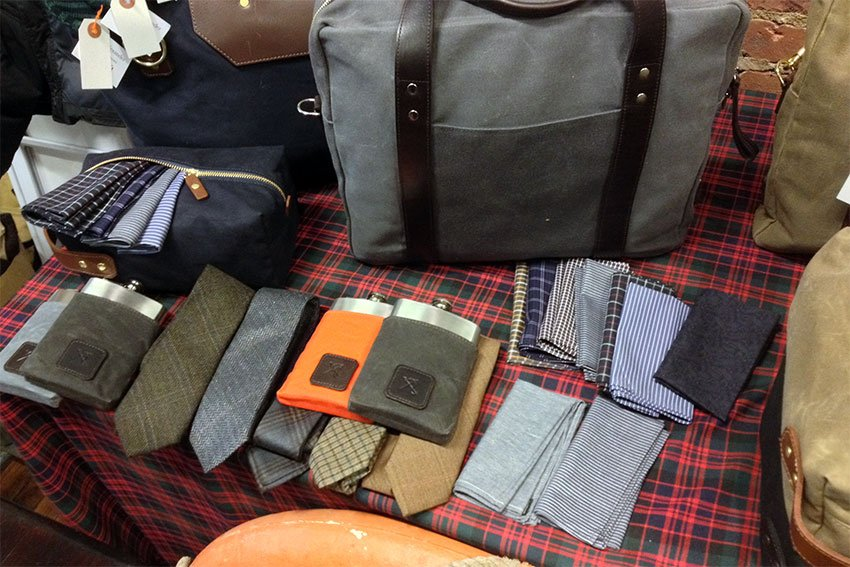 Some of Ernest Alexanders many products, including a charcoal grey Watson briefcase.